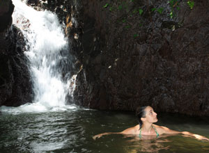 Enjoy a swim beneath a waterfall near Playa Cativo