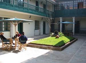 Relax in the courtyard at Casa Andina Koricancha