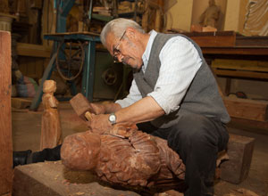 Watch a skilled woodcarver at work